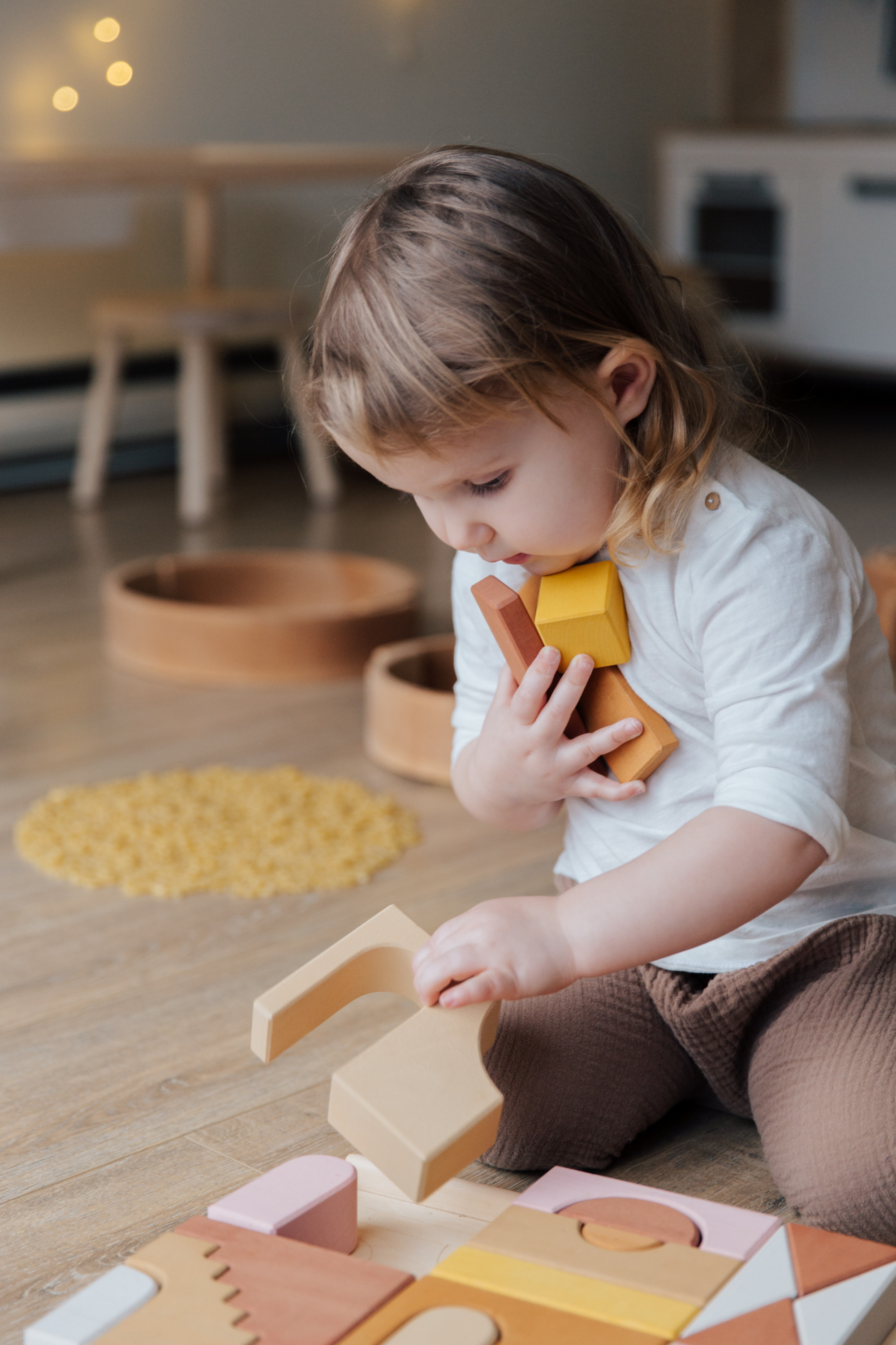 photo-of-child-holding-wooden-blocks-3933276