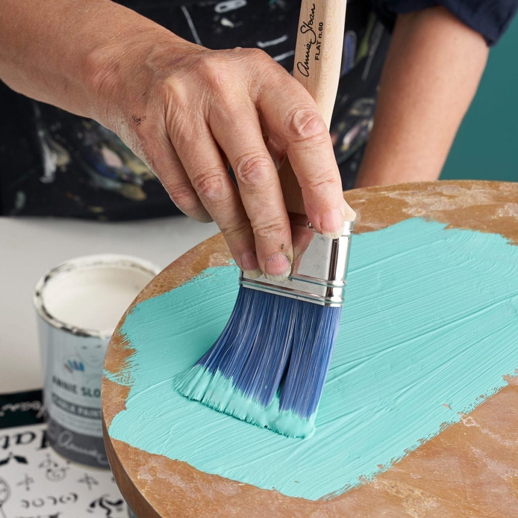 Annie-Sloan-using-Chalk-Paint-furniture-paint-in-a-mix-of-Florence-and-OId-White-to-paint-a-table-using-a-Flat-Brush-1200-1024x1024